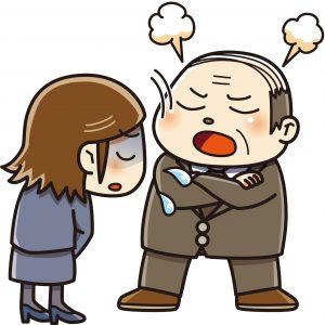 怒る男性とうなだれる女性の画像