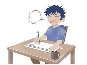 勉強しながら溜息つく男性
